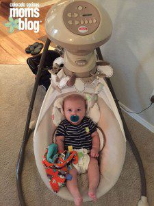 A baby in a swing is a happy baby!
