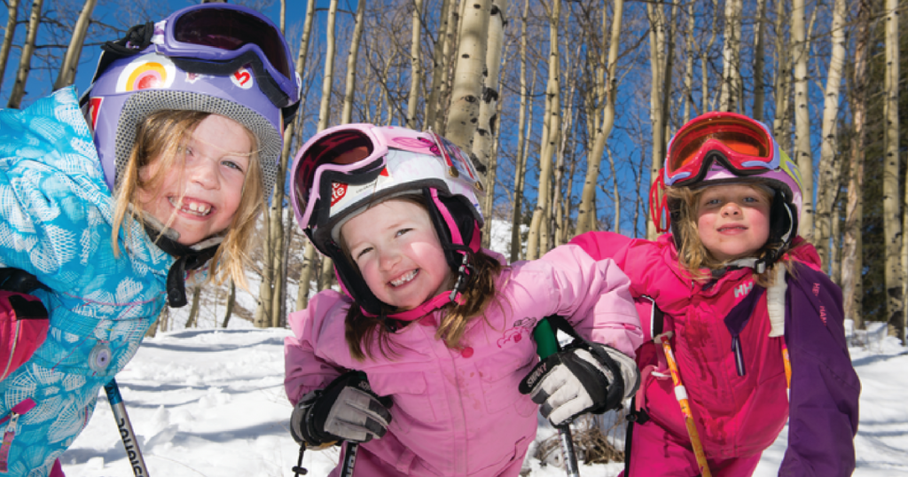 Three girls in ski gear at Crested Butte.