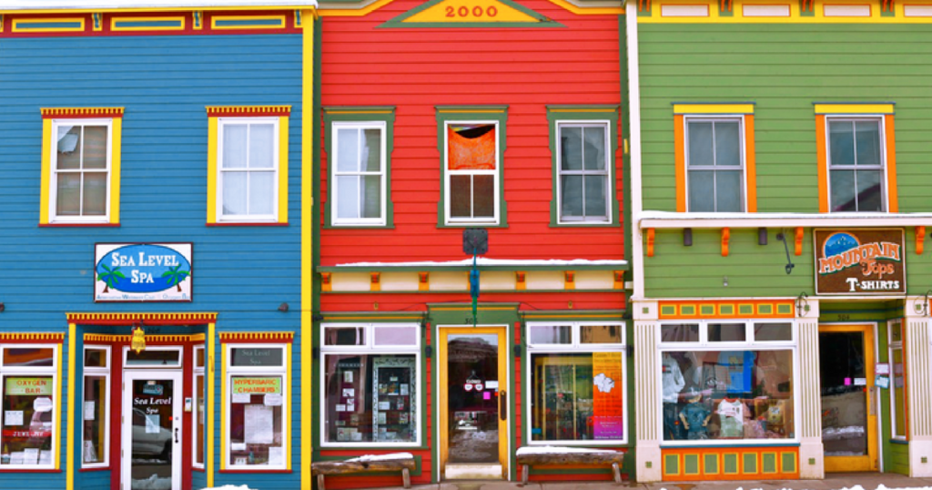 Three brightly colored buildings in downtown Crested Butte.